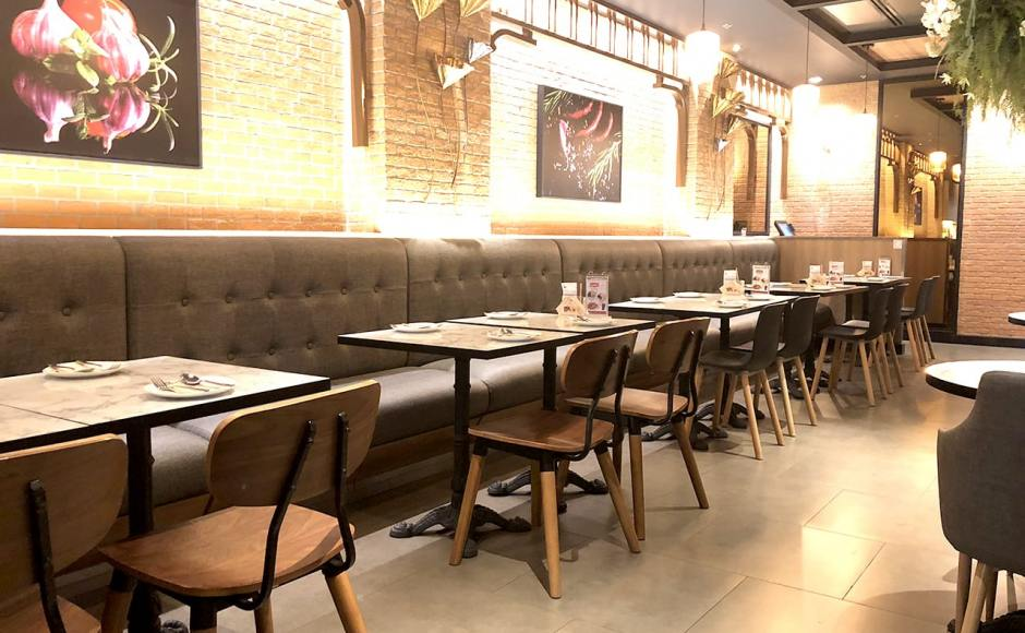 Bangkok Cafe - The Move, Mandalay, Myanmar | Product Seen: [Customised Laminate Tabletop + Paris Table Base – V2, Spark Chair &amp; Plug + Round Leg Chair]<br />