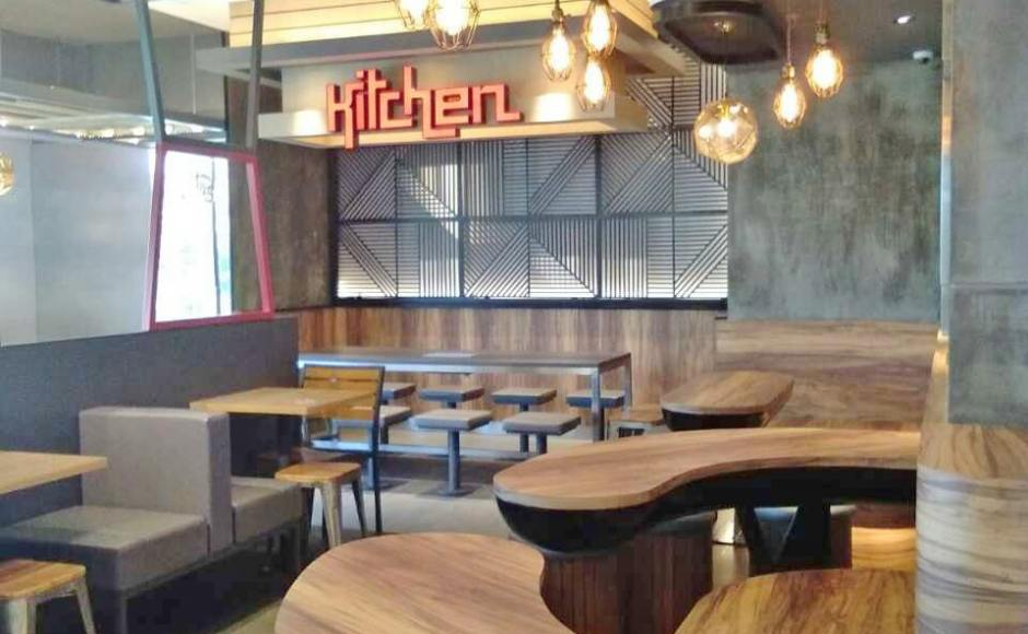 KFC - Junction City, Yangon, Myanmar | Products seen: [Light Hang – Cage, Dojo Low Stool – Wood Seat & Stripes Stool]<br />