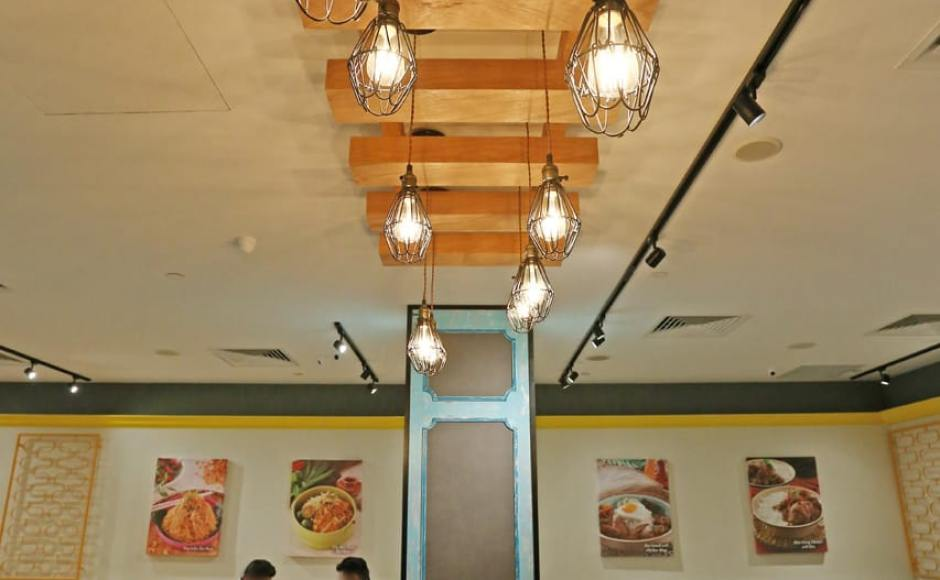 Curry Times by Old Chang Kee - Singpost Centre | Products Seen: [Tang Stool – Square, Light Hang – Cage & Antique Table Base with Customised Tabletop]