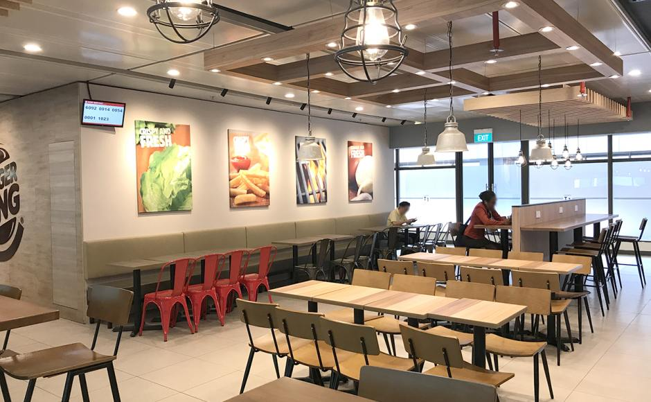 Burger King - Changi Airport Teminal 1 | Product Seen: [Leo Side Chair - Steel Seat, Customised Laminated Tabletop + Filo Table Base - V2 / Flushed Table Base – Steel (for floor mounting) & Customised Furniture]