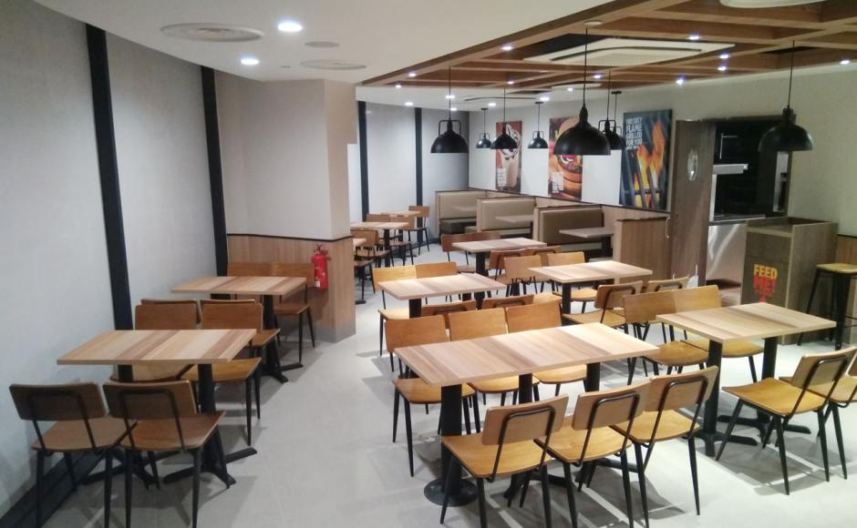 Burger King - Loyang Point | Product Seen: [Customised Dining Chair, Customised Laminate Tabletop + Filo Table Base & Customised Laminate Tabletop + Mounty Table Base – Steel (for floor mounting)]<br />