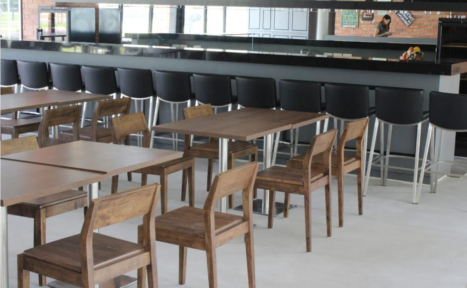 Patro's Sports Bar - East Coast Parkway | Products seen: [Reese Chair, Bravo Barchair & Customised Table in Traxtor Square Table Base]