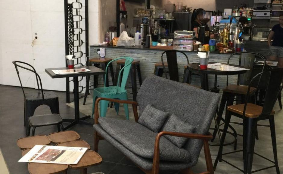 Ollie Cafe - Orchard Gateway | Products Seen: [Emma 2–Seater Sofa, Clove Coffe Table & Dojo Barchair Rust + Wood]