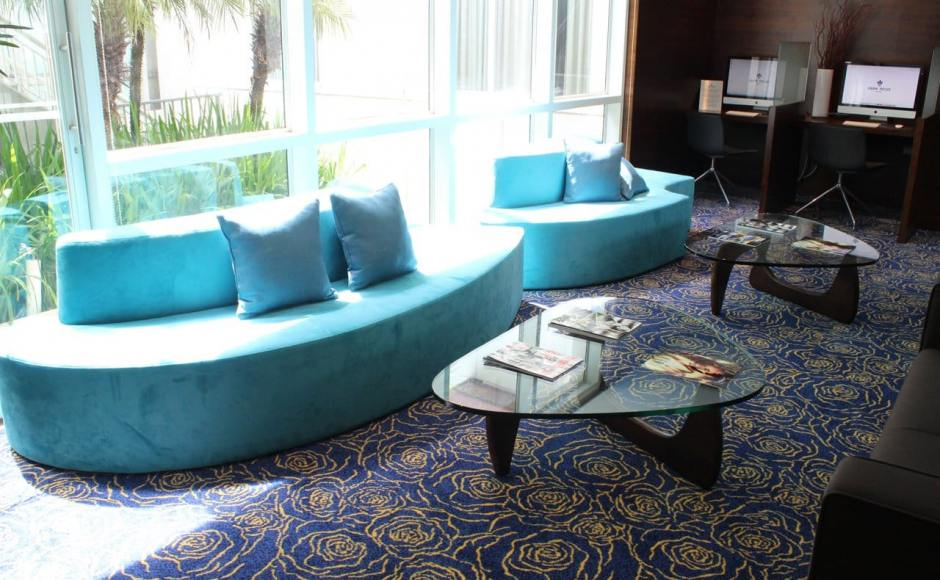 Park Regis Hotel - 23 Merchant Road | Products Seen: [Wave Modular Sofa & Noguchi Coffee Table (Replica)]<br />