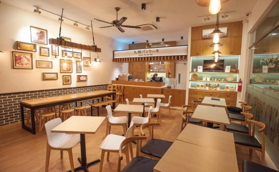 Kyushu Pancake Cafe - Novena | Products Seen: [Customised Bourne Bench - Black Steel, Uni (flushed) Dining Table w/ Butcher Top, Customised Table Top + Filo Table Base, Kiki Stool, Gum - Half Fabric + Tower Armchair, Plug + Square Leg Chair & Osaka Sidechair]<br />
