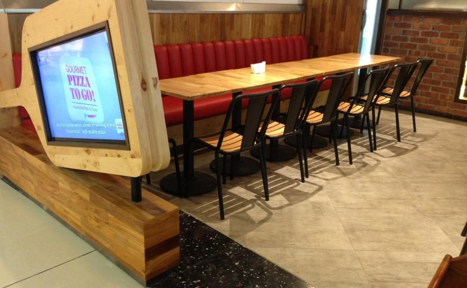 Gourmet Pizza To Go - Sports Hub | Products seen: [Cosson Table Base &amp; Blake Wood Sidechair]<br />