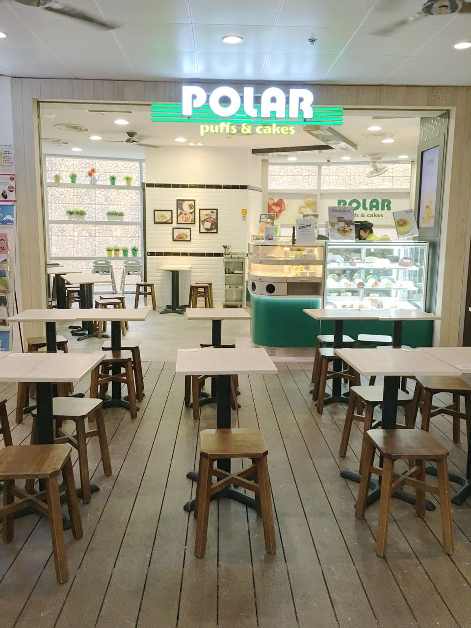Polar Puffs & Cakes - United Square | Products Seen: [Tang Stool – Square & Filo Table Base with Customised Tabletop]<br />