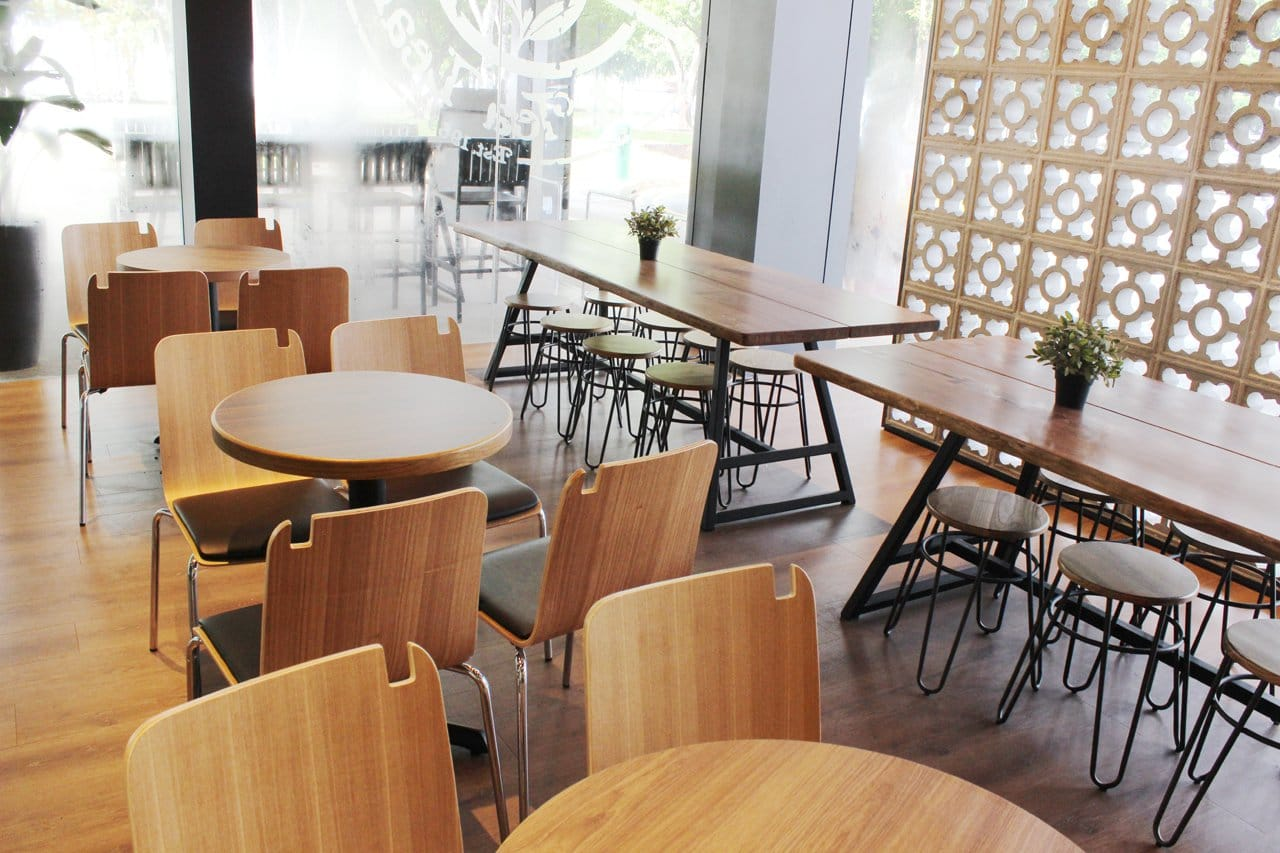 Coffee Bean @ Marine Cove | Products seen: [Anderson Dining Table, Hansel Stool - Wood + Rust, Swiss Chair & Customised coffee table with Filo Table Base]<br />