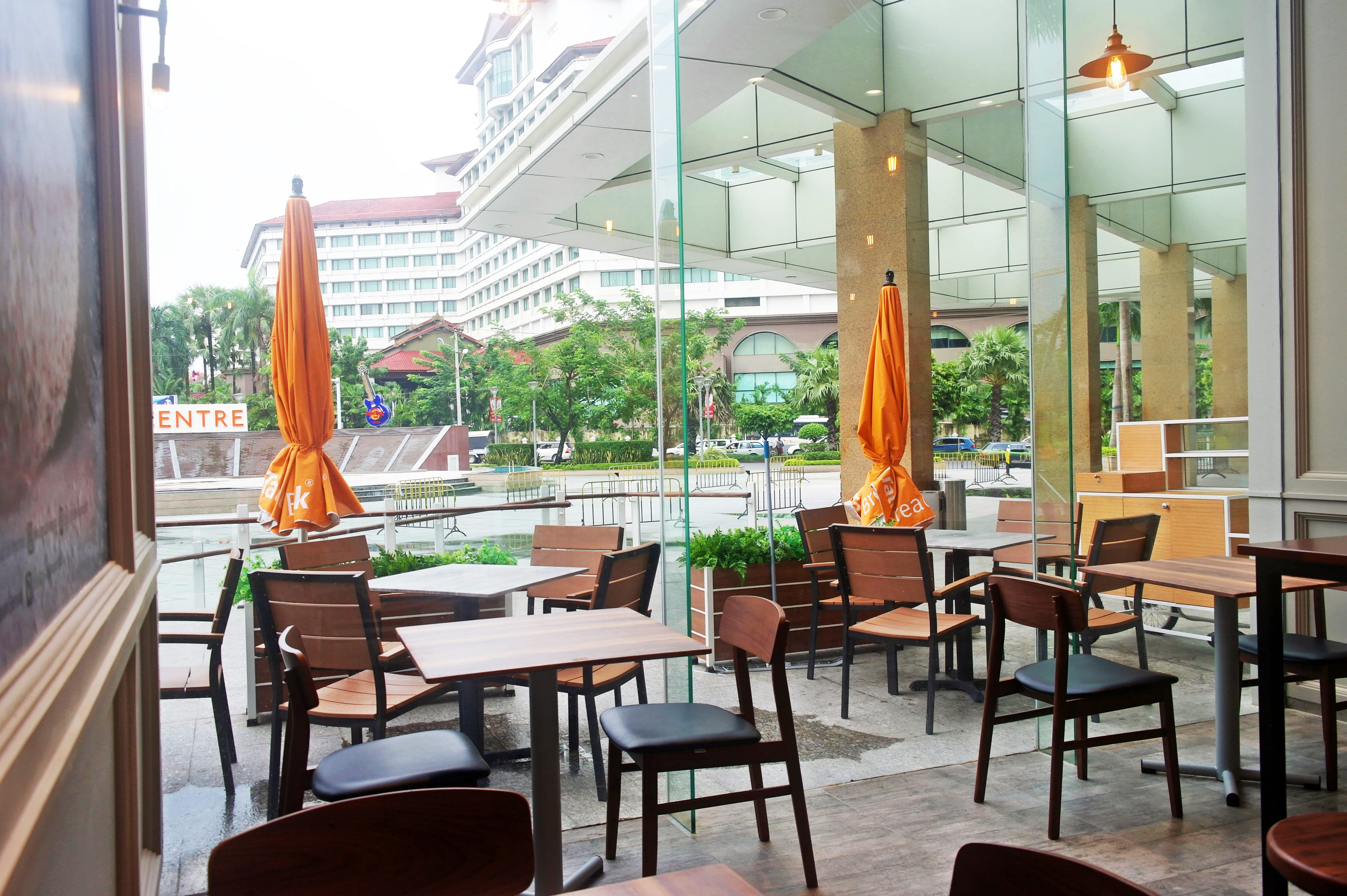 Breadtalk, Myanmar Plaza - Yangon, Myanmar | Product Seen: [Fossil Outdoor Armchair, Ottawa Chair, Isotop - Outdoor Table Top – Indian Rosewood colour & Isotop - Outdoor Table Top – Cement colour]