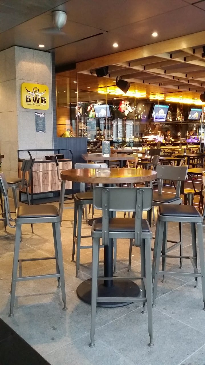 BWB (Burger VS Wings + Bar) - Orchard Central | Product Seen: [Lick Barchair, Butcher Block Top & Cosson High Base]<br />