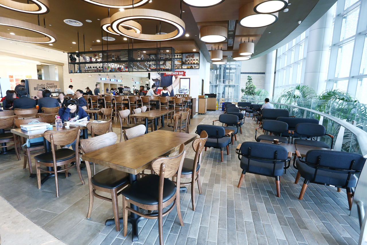 O'Coffee Club - Changi Airport Terminal 4 | Product Seen: [Journey Barchair – Cocoa, Journey Sidechair, Astro 1–Seater & Sofa Astro 2–Seater Sofa]