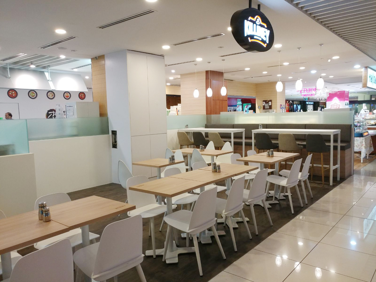 Killiney Cafe - Suntec City | Product Seen: [Troy Chair, Hopkins + 4P Chair, Amelia Barchair, Tapered Backrest Booth (Storage optional) & Customised Laminated Tabletop + Pattaya Table Base]<br />