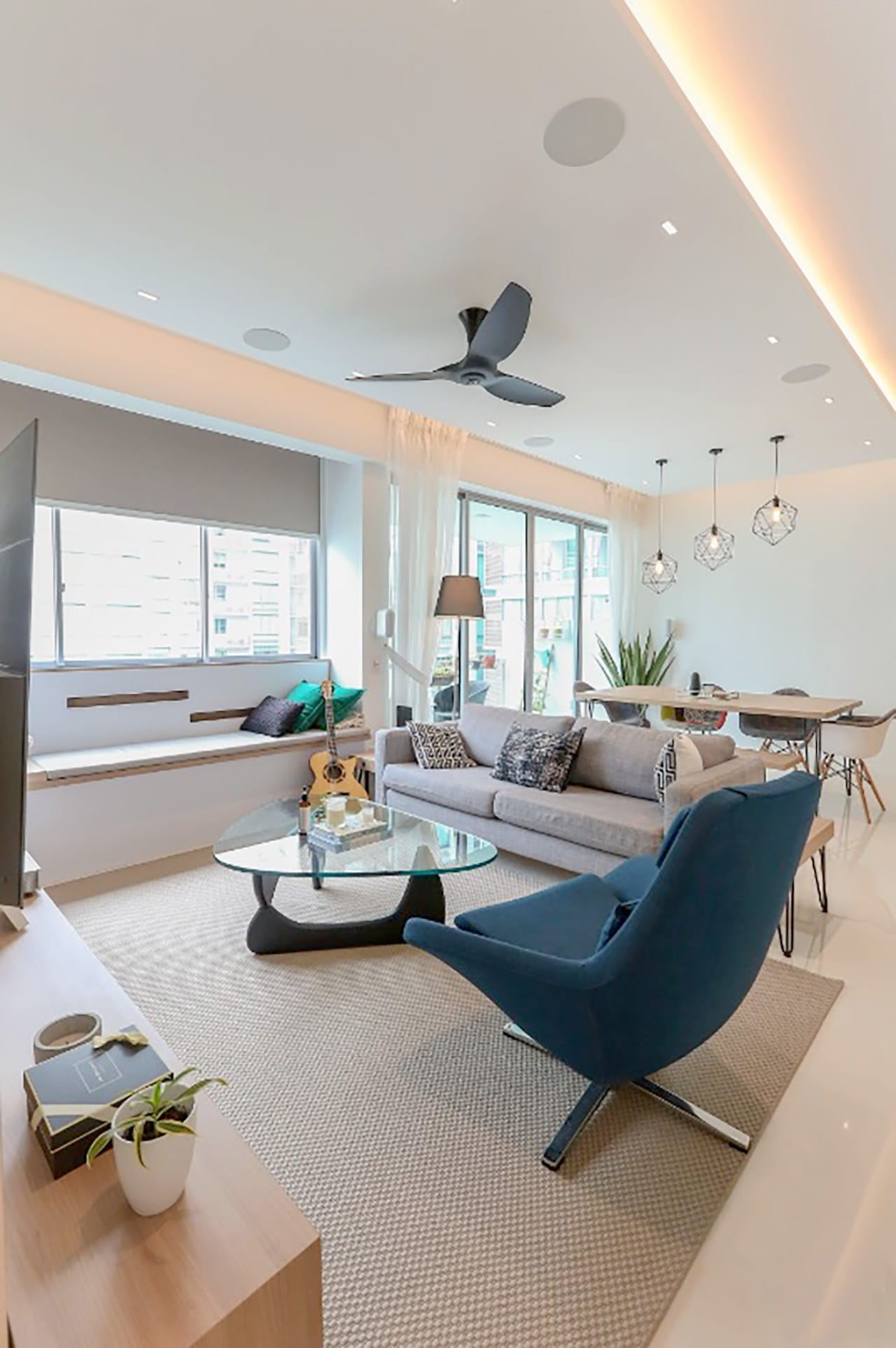 Apartment - One North Residence (HomeRenoGuru.sg) | Product Seen: [Rykiel Lounger, Noguchi Coffee Table (replica), Customised Laminate tabletop + Hairpin Table Base & Gum – Half Fabric + Tower Arm chair]