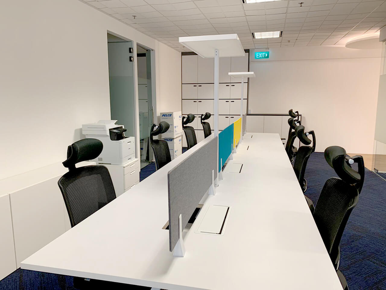 Pelco Asia Pacific - The Concourse | Product Seen: [Gabriel Highback Office Chair, Apex Workstation, Cable Management Flip Cover – 4 Sockets & Light Table - Wisdom]