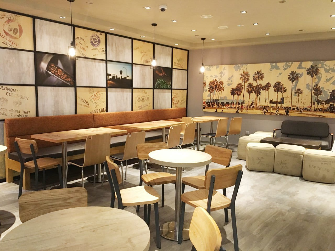 Coffee Bean - Centrepoint | Product Seen: [Toyo Chair – Wood + Epoxy, Swiss Chair, Astro 2 Seater Sofa & Customised Laminate Tabletop + Traxtor Round Table Base]<br />
