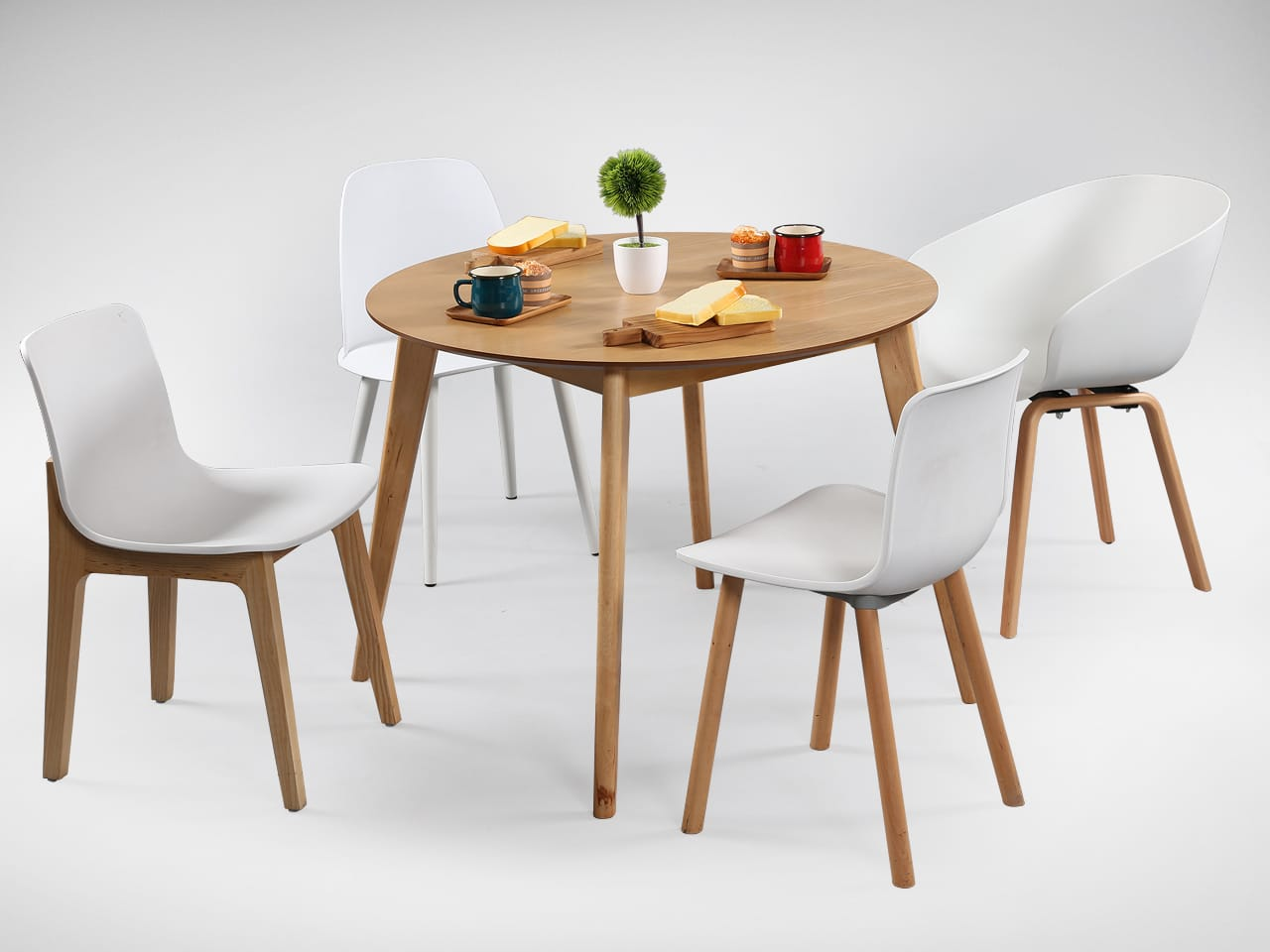 [Ariel Armchair, Plug + Square Leg Chair, Plug + Round Leg Chair,Troy Chair & Oakland Round Dining Table – Natural]<br />